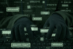 Closeup of hacker hands typing on keyboard Stock Photo