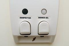 Closeup of hair soap dispenser Royalty Free Stock Photos
