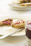 Closeup Of Half Eaten Toast With Jam Royalty Free Stock Photography