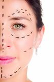 Closeup half of face caucasian woman with dotted lines drawn around left eye, preparing cosmetic surgery Stock Photo