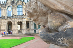 Closeup half naked faunus statue playing panpipe at Zwinger pala Stock Image