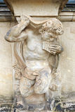 Closeup half naked satyr statue playing panpipe at Zwinger palac Royalty Free Stock Photography