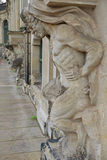 Closeup half naked satyr statues row at Zwinger palace in Dresde Stock Photo
