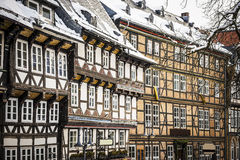 Closeup half-timbered houses in Goslar, Germany. Closeup of half-timbered houses in Goslar, Germany in winther with snowfall Stock Images