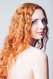 Portrait of beautiful smiling redhead girl Royalty Free Stock Photo