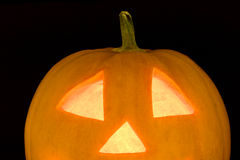Closeup of halloween pumplin lightened face Royalty Free Stock Image