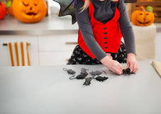 Closeup on hallowen dressed girl with scary toys. Close up on halloween dressed girl with scary toys in decorated kitchen. Ready to halloween party. Traditional Royalty Free Stock Photos