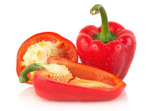 Closeup halved red bell peppers isolated on white Stock Photo