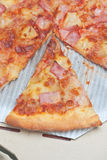 Closeup of ham topping pizza Royalty Free Stock Photo