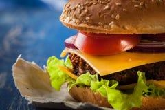 Closeup of hamburger on paper Stock Images
