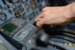 Closeup hand on aircraft controls Royalty Free Stock Photo