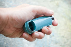 Closeup of hand with asthma aerosol Stock Images