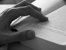 Closeup hand and book Stock Photos