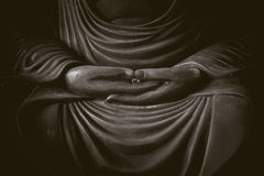 Closeup hand of buddha in the dark. Closeup hand of buddha, peacful asian buddha zen tao religion art style statue Stock Photo