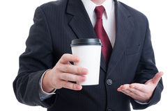 Closeup with hand of businessman holding coffee to go cup Royalty Free Stock Photos