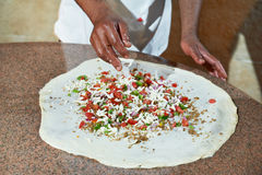 Pizza preparartion Stock Images