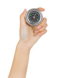 Closeup hand and compass Stock Image