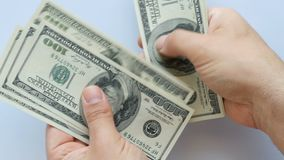 Closeup hand counting 100 us dollar bills stock footage
