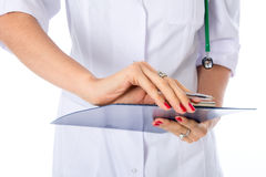 Closeup hand of a doctor with writing tablet. Diagnosis Stock Photos