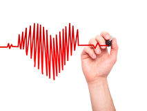 Closeup of hand drawing heart beat in heart shape with stethosc stock photos