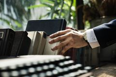 Closeup of hand getting a book stock image