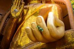 Closeup at hand of Gold big buddha statue temple wat tham sua Royalty Free Stock Photo