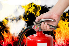 Closeup hand handle fire extinguisher Royalty Free Stock Images