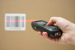 Closeup of hand holding bar code scanner   Stock Photo