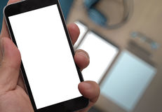 Closeup of Hand holding Blank Screen of Smart phone. With blurred background as concept Royalty Free Stock Photography