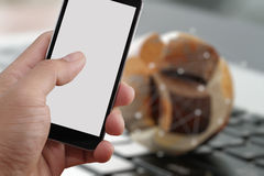 Closeup of Hand holding Blank Screen of Smart phone. With blurred background as concept Stock Image