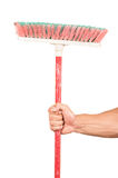 Closeup of hand holding a broom. Isolated on white Stock Images
