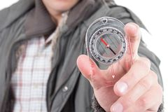 Closeup of hand holding a compass Royalty Free Stock Photos