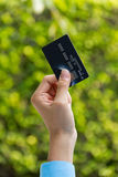Closeup of hand holding credit card, ready for payment Stock Photo