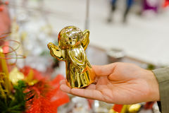 Closeup of hand holding golden christmas angel royalty free stock images