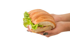 Closeup of hand holding lettuce and ham sandwich Royalty Free Stock Images