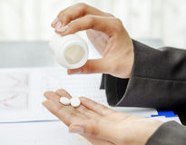 Closeup of hand holding medicine Stock Photo