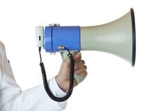 Closeup of a hand holding a megaphone. Royalty Free Stock Photos
