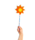 Closeup on hand holding pinwheel Royalty Free Stock Images