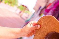 Closeup hand holding up a beige panama style hat Stock Images