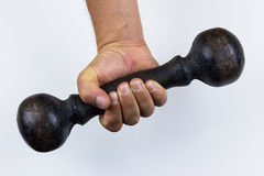 Closeup of hand holding vintage dumbell stock photography