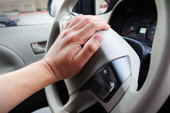 Closeup of hand honking car horn Royalty Free Stock Images