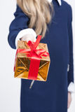 Closeup of Hand of Little Blond Girl Giving Christmas Gift Box F Royalty Free Stock Images