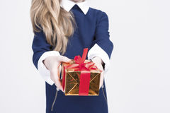 Closeup of Hand of Little Blond Girl Giving Christmas Gift Box Stock Image