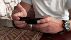 Closeup hand of man using phone in cafe.  stock video footage