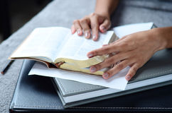 Closeup hand open book for reading concept background. Closeup hand open book for reading concept Royalty Free Stock Image