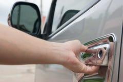 Closeup hand open door of van transportation. Close up hand open door of van transportation Royalty Free Stock Images
