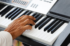 Closeup hand of pianist playing a piano. Closeup hand of musician pianist playing a piano. Shallow focus Stock Photos