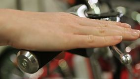 Closeup of hand pressing brake lever on bike handle, active lifestyle, cycling stock video
