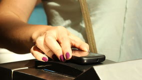 Closeup  hand put the phone to ntfs system in metro for payment. Closeup  female hand with manicure bring the phone to  ntfs system reader in metro turnstile for stock video footage