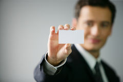 Closeup on hand showing business card Stock Images